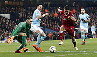 Liverpool's Roberto Firmino gets away from Manchester City's Ederson (left) and Kyle Walker<br /> <br /> Photographer Rich Linley/CameraSport<br /> <br /> UEFA Champions League Quarter-Final Second Leg - Manchester City v Liverpool - Tuesday 10th April 2018 - The Etihad - Manchester<br />  <br /> World Copyright &copy; 2017 CameraSport. All rights reserved. 43 Linden Ave. Countesthorpe. Leicester. England. LE8 5PG - Tel: +44 (0) 116 277 4147 - admin@camerasport.com - www.camerasport.com