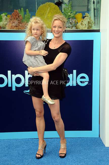 WWW.ACEPIXS.COM . . . . .  ....September 17 2011, LA....Actress Teri Polo (R) and her daughter arriving at the Premiere of 'Dolphin Tale' at The Village Theatre on September 17, 2011 in Westwood, California. ....Please byline: PETER WEST - ACE PICTURES.... *** ***..Ace Pictures, Inc:  ..Philip Vaughan (212) 243-8787 or (646) 679 0430..e-mail: info@acepixs.com..web: http://www.acepixs.com