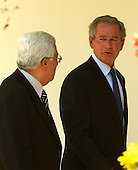 United States President George W. Bush and Prime Minister Mahmoud Abbas of the Palestinian Authority share some thoughts as they walk along the collonnade at the White House in Washington, DC on July 25, 2003 as they retired to lunch in the Residence..Credit: Ron Sachs / CNP