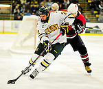 29 December 2010: University of Vermont Catamount forward Tobias Nilsson-Roos, a Sophomore from Malmo, Sweden, maintains control of the play against the 2011 U.S. Men's National University Team during an exhibition game at Gutterson Fieldhouse in Burlington, Vermont. The Catamounts defeated the National team 7-1. Mandatory Credit: Ed Wolfstein Photo