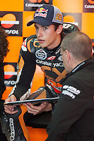 Marc Marquez with engineers in boxes