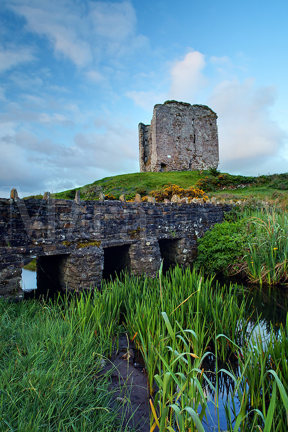 Minard Castle above sandstone bridge over small creek, Dingle Peninsula, County Kerry, Republic of Ireland