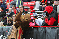 College Park, MD - November 26, 2016: Maryland Terrapins mascot takes a picture with a fan during game between Rutgers and Maryland at  Capital One Field at Maryland Stadium in College Park, MD.  (Photo by Elliott Brown/Media Images International)