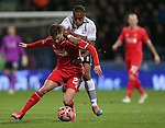 Adam Lallana of Liverpool tussles with Neil Danns of Bolton - FA Cup Fourth Round replay - Bolton Wanderers vs Liverpool - Macron Stadium  - Bolton - England - 4th February 2015 - Picture Simon Bellis/Sportimage