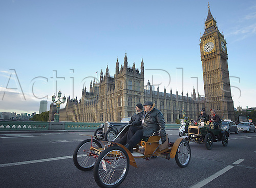 3.11.2013 London, England.  Competitor #260 entered by Mr Lloyd Bailey [GBR} USU 507 1904 Orient, on Westminster Bridge pass Big Ben and the Houses Of Parliament, during the annual 'London to Brighton Veteran Car Run' on November 03, 2013 organised by the Royal Automobile Club. The Royal Automobile Club's 60 mile drive from the capital to the south coast is the longest running motoring event in the world, and attracts entrants from across the globe.