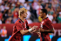 Brek Shea (17) of the United States checks in for Jermaine Jones (8). The men's national teams of the United States (USA) and Mexico (MEX) played to a 1-1 tie during an international friendly at Lincoln Financial Field in Philadelphia, PA, on August 10, 2011.
