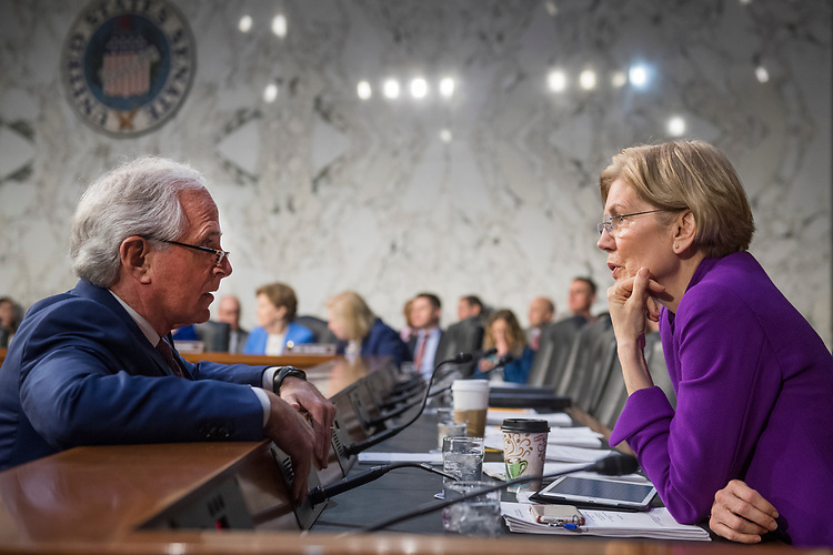 UNITED STATES - FEBRUARY 08: Sen. Bob Corker, R-Tenn., talks with Sen. Elizabeth Warren, D-Mass., during a Senate Armed Services Committee hearing on nominations in Hart Building on February 8, 2018. Corker introduced Paul C. Ney Jr., nominee to be the General Counsel of the Department of Defense. (Photo By Tom Williams/CQ Roll Call)