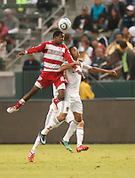 CARSON, CA – OCTOBER 24: FC Dallas midfielder Marvin Chavez and LA Galaxy defender Sean Franklin during a soccer match at the Home Depot Center, October 24, 2010 in Carson, California. Final score LA Galaxy 2, Dallas FC 1.