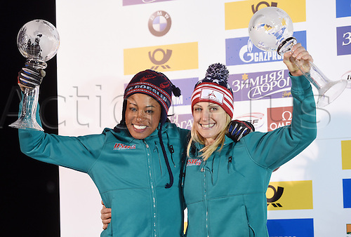 26.02.2016. Koenigssee,  Berchtesgaden, Germany.  US-American Bobsleigh pilots Jamie Greubel Poser (r) and Lauren Gibs holding up their trophies for the second place at the 2-women Bobsleigh World Cup at Koenigssee