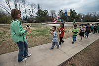 NWA Democrat-Gazette/ANTHONY REYES @NWATONYR<br /> Mary Ann Brinkman leads her first grade students inside Friday, March 17, 2017 after recess at Lee Elementary School in Springdale.