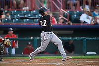 Richmond Flying Squirrels third baseman Christian Arroyo (22) hits a double during a game against the Erie SeaWolves on May 27, 2016 at Jerry Uht Park in Erie, Pennsylvania.  Richmond defeated Erie 7-6.  (Mike Janes/Four Seam Images)