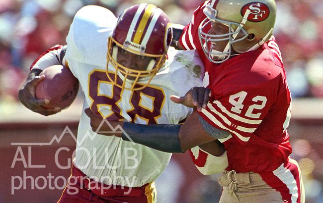 San Francisco 49ers vs Washington Redskins at Candlestick Park Sunday, September 16, 1990..49ers beat Redskins 26-13.49er defensive back Ronnie Lott (42) tackles  Redskin tight end Jimmie Johnson (88)..