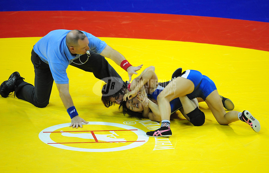 Jun 13, 2008; Las Vegas, NV, USA; Clarissa Chun (blue) battles Patrcia Miranda during the final in the womans 48kg class at the 2008 US Olympic Team Trials at the Thomas and Mack Center. Chun won the match and qualified for the Olympics. Mandatory Credit: Mark J. Rebilas-