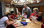 Merrill and Roberta Simon talk with some of their 21 children while preparing for dinner at their Mound House, Nev. home, on Monday, Dec. 19, 2011. From left are, LisaMarie 12, Maverick, 3,  Joey, 8, Macylea, 2, and Montana, 1..Photo by Cathleen Allison