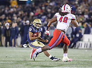 Annapolis, MD - November 11, 2017: Navy Midshipmen running back Malcolm Perry (10) avoids Southern Methodist Mustangs linebacker Anthony Rhone (48) during the game between SMU and Navy at  Navy-Marine Corps Memorial Stadium in Annapolis, MD.   (Photo by Elliott Brown/Media Images International)