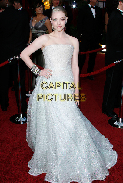AMANDA SEYFRIED.The 82nd Annual Academy Awards held aat The Kodak Theatre in Hollywood, California, USA..March 7th, 2010 .oscars full length Armani prive strapless princess gown dress hand on hip white grey gray off long maxi full skirted beaded sparkly cuff silver bracelet .CAP/EAST.©Eastman/Capital Pictures.