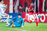 Guangzhou Forward Alan Douglas De Carvalho (R) attempts a kick while being defended Kashima Goalkeeper Kwoun Suntae (L) during the AFC Champions League 2017 Round of 16 match between Guangzhou Evergrande FC (CHN) vs Kashima Antlers (JPN) at the Tianhe Stadium on 23 May 2017 in Guangzhou, China. (Photo by Power Sport Images/Getty Images)