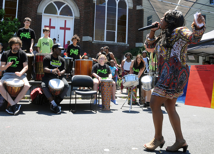 Master of Ceremonies, Ashley Knox, encouraging the audience at the 11th Annual Mid-town Make a Difference Day Celebration on Franklin Street, in Kingston, NY on Saturday, June  18, 2016. Photo by Jim Peppler. Copyright Jim Peppler 2016.