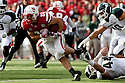 29 October 2011: Marcus Rush #44 of the Michigan State Spartans tackles Rex Burkhead #22 of the Nebraska Cornhuskers during the second quarter at Memorial Stadium in Lincoln, Nebraska.  Nebraska defeated Michigan State 24 to 3.