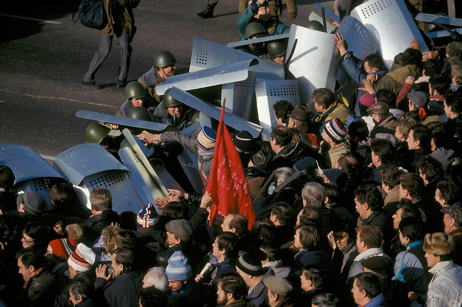 Moscow, Russia, 03/10/1993..Opposition demonstrators attack riot police attempting to prevent them from marching to the Russian Parliament,  which rebel Communist and nationalist deputies, led by Vice-President Alexander Rutskoi, had occupied after President Boris Yeltsin dissolved the parliament..