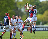 Nick Koster competes for the ball in the air. Greene King IPA Championship match, between London Scottish and Bristol Rugby on April 26, 2014 at the Richmond Athletic Ground in London, England. Photo by: Patrick Khachfe / Onside Images