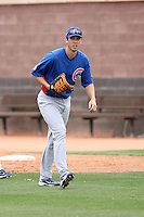 Tyler Colvin #21 of the Chicago Cubs participates in infield practice during spring training workouts at the Cubs complex on February 19, 2011  in Mesa, Arizona. .Photo by Bill Mitchell / Four Seam Images.
