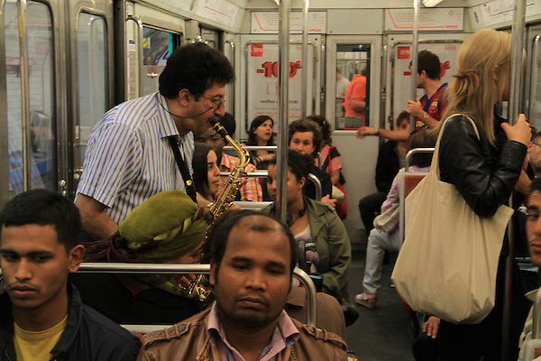 Man playing saxophone on the Paris Metro, Paris, France. .  John offers private photo tours in Denver, Boulder and throughout Colorado, USA.  Year-round. .  John offers private photo tours in Denver, Boulder and throughout Colorado. Year-round.