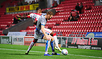 Lincoln City's Cian Bolger shields the ball from Doncaster Rovers' Niall Ennis<br /> <br /> Photographer Chris Vaughan/CameraSport<br /> <br /> EFL Leasing.com Trophy - Northern Section - Group H - Doncaster Rovers v Lincoln City - Tuesday 3rd September 2019 - Keepmoat Stadium - Doncaster<br />  <br /> World Copyright © 2018 CameraSport. All rights reserved. 43 Linden Ave. Countesthorpe. Leicester. England. LE8 5PG - Tel: +44 (0) 116 277 4147 - admin@camerasport.com - www.camerasport.com