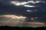 Sunrbeams stream through the cloud cover above Vashon Island, WA.  Jim Bryant Photo. ©2014. All Rights Reserved.