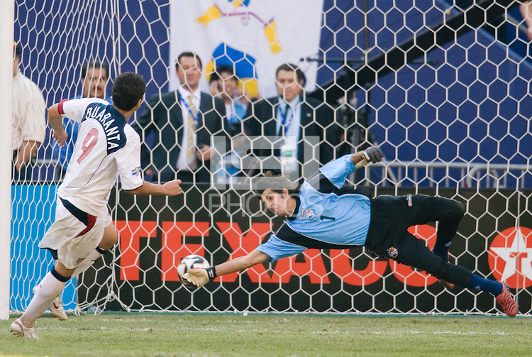 Panama's goalkeeper Jaime Penedo can not stop Santino Quaranta of the USA during the shoot out. The United States defeated Panama in a shoot out after a scoreless game to win the CONCACAF Gold Cup at Giant's Stadium, East Rutherford, NJ, on July 24, 2005.