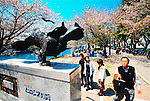 Visitors look at the Hiroshima Peace Monument, which is located in the Hiroshima Peace Memorial Park in Hiroshima, Japan. The Peace Park, dedicated to the people who fell victim to the world's first nuclear attack, was once the setting for the city's bustling business district, which was flattened by the atomic bomb dropped on the city on August 6, 1945.