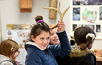 Kate Duncan, a fourth grade student from Vandergiff Elementary School, holds up an antler Monday, January 13, 2020, at the Lake Fayetteville Environmental Study Center in Springdale. Students from  Rebecca Wilbern's class in Fayetteville spent half of the day learning inside center and the second half on a nature hike on the Environmental Study Center Trail. Check out nwaonline.com/200114Daily/ and nwadg.com/photos for today's photo gallery.<br /> (NWA Democrat-Gazette/David Gottschalk)