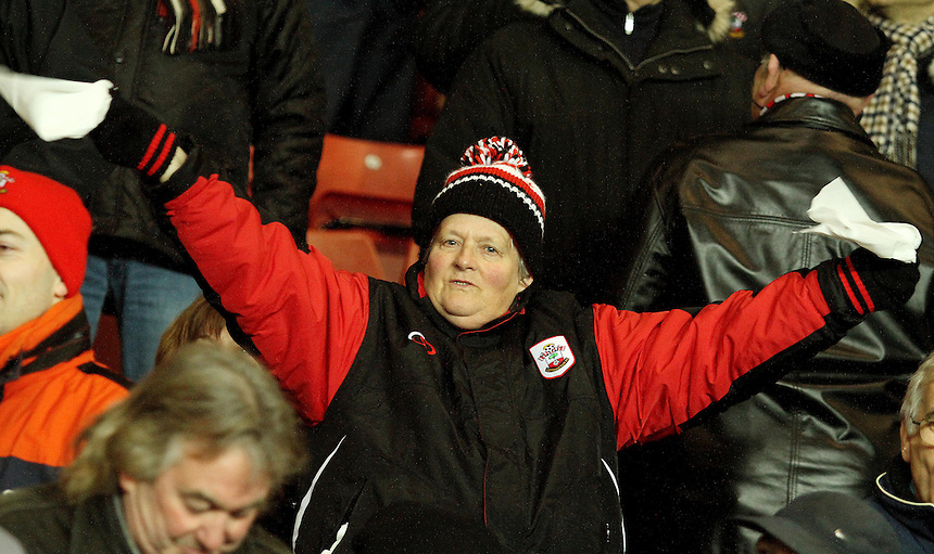 A fan waves white hankies in protest for the sacking of Nigel Atkins...- Credit - CameraSport - James Marsh - ..Football - Barclays Premiership - Southampton v Everton - Monday 21st January 2013 - St Mary's - Southampton..