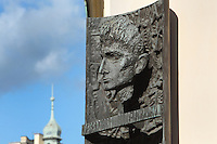 Bronze plaque with a bust of Franz Kafka, 1883-1924, Czech writer and philosopher, on the corner of his Birthplace House on the corner of Kaprova Street and Maiselova Street, Jewish quarter, Prague, Czech Republic. Kafka was born in this house on July 3rd 1883 and lived here with his parents for 2 years. A memorial plaque and the name of the square commemorate Franz Kafka. The historic centre of Prague was declared a UNESCO World Heritage Site in 1992. Picture by Manuel Cohen