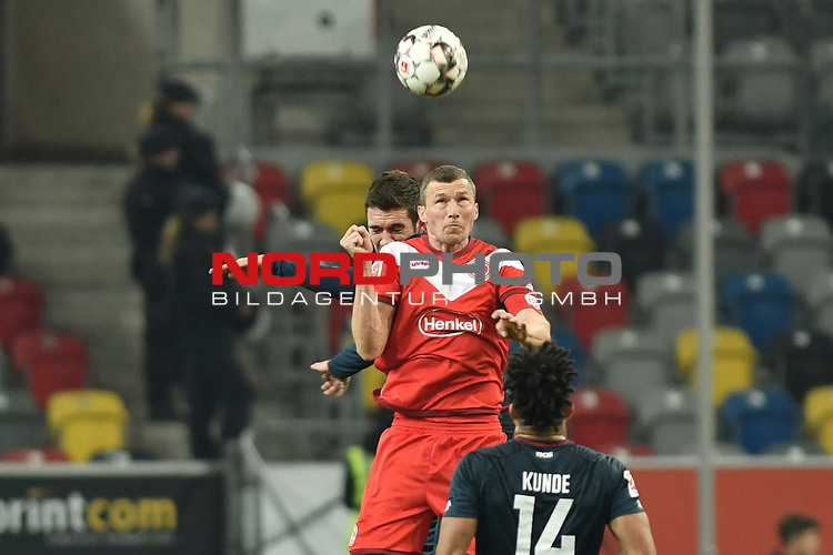 30.11.2018, Merkur Spiel-Arena, Düsseldorf / Duesseldorf, GER, 1.FBL, Fortuna Düsseldorf / Duesseldorf vs 1. FSV Mainz 05, DFL regulations prohibit any use of photographs as image sequences and/or quasi-video<br /> <br /> im Bild Kopfball / Kopfballduell Stefan Bell (#16, FSV Mainz 05) Oliver Fink (#7, Fortuna Düsseldorf / Duesseldorf) <br /> <br /> Foto © nordphoto/Mauelshagen