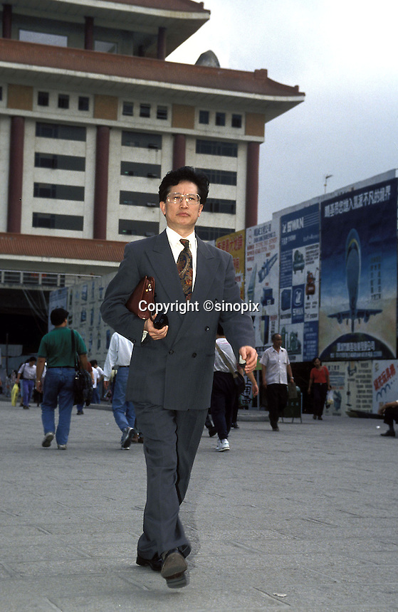 A Hong Kong businessman crosses the border into Shenzhen.