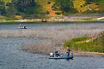 Fishermen in boats at Lopez Lake Recreation Area, near Arroyo Grande, San Luis Obispo County, California