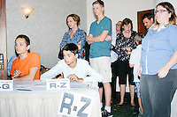 Volunteers wait to check in people before Republican presidential candidate Dr. Ben Carson speaks at a town hall campaign stop at a meeting of the Windham Republican Town Committee at the Castleton Banquet and Conference Center in Windham, New Hampshire.