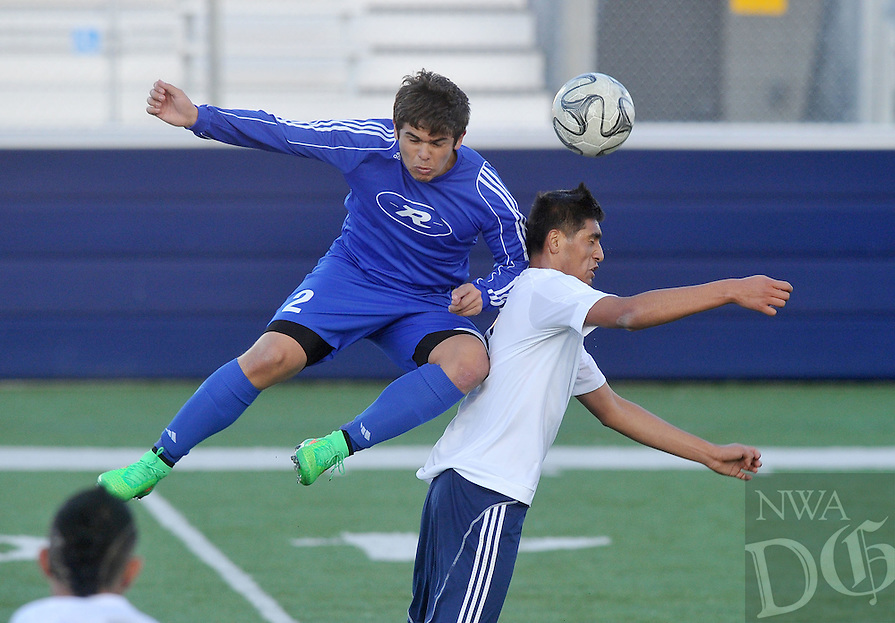 NWA Democrat-Gazette/Michael Woods --04/03/2015--w@NWAMICHAELW... Rogers Alex Valdez (left) and Har-Ber's Jimmy Araujo go after the ball during Friday nights game at Har-Ber High School in Springdale.