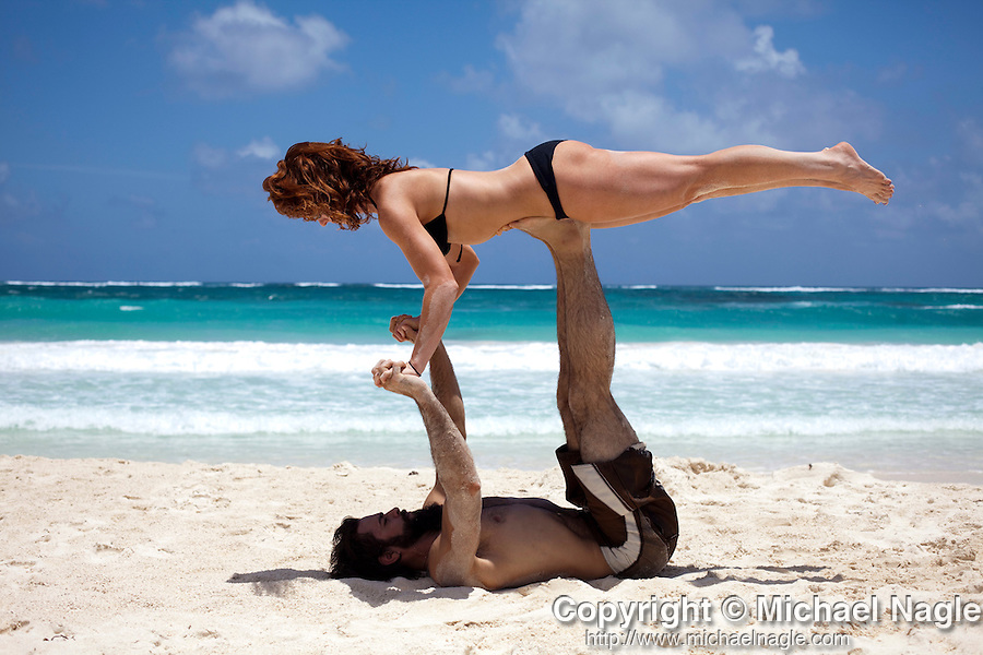 TULUM, MEXICO - APRIL 29, 2009: Dawnell Arthur and Sam Nanfito, both from Denver, practice a yoga pose on the beach in front of Ocho Tulum on April 29, 2009 in Tulum, Mexico.  (PHOTOGRAPH BY MICHAEL NAGLE)