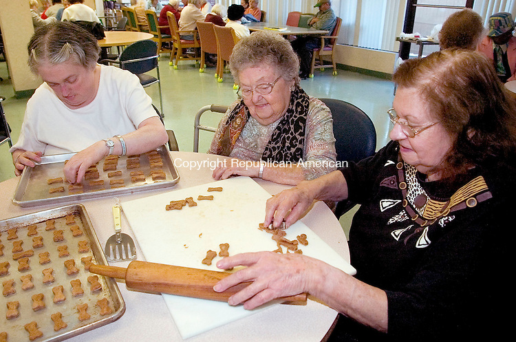 MIDDLEBURY, CT -30 NOVEMBER 2007 -113007DA002- Betty Exarhos, from right, cuts out dog biscuits with the help of her fellow Red Hat Society members, Jane Zenbruski and Rosanne Myers at the Senior Care Center in Middlebury Friday. The biscuits will be donated to the Connecticut Human Society for the holidays.<br /> Darlene Douty/Republican-American