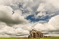 Abandoned schoolhouse and clouds, Palouse region of eastern Washington