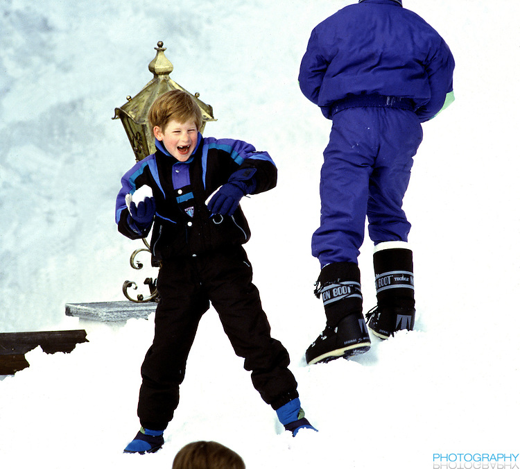 Prince Harry throwing snowballs in Lech, Austria, during an annual ski holiday with his mother, The Princessof Wales, and brother Prince William