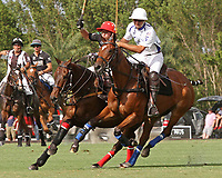 WELLINGTON, FL - APRIL 15:  Santi Torres of Palm Beach Illustrated (red helmet) and Pablo Spinach of Valiente. Scenes from the $100,000 World Cup Final, at the Grand Champions Polo Club, on April 15, 2017 in Wellington, Florida. (Photo by Liz Lamont/Eclipse Sportswire/Getty Images)