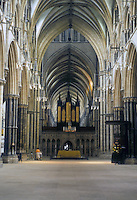 """Lincoln: Lincoln Cathedral--Vaulting over Nave, Crossing and Choir ahead. """" ..The..squat proportions are typical  of Eng. Arch. in the late 13th century"""" ARCH. OF WESTERN WORLD, p. 43. Photo '90."""