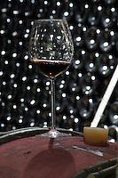 glass of wine on a barrel in cellar domaine guyot marsannay cote de nuits burgundy france