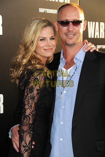 """Brooke Burns & Gavin O' Connor.""""Warrior"""" World Premiere held at Arclight Cinemas, Hollywood, California, USA..September 6th, 2011.half length dress suit jacket blue shirt sunglasses shades couple side black lace smiling  .CAP/ADM/BP.©Byron Purvis/AdMedia/Capital Pictures."""