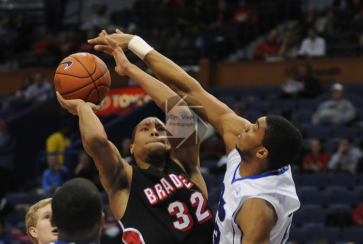 March 3,  2011       Bradley Braves guard Dyricus Simms-Edwards (32) tries to shoot on the basket as Drake Bulldogs forward Kraidon Woods (22) reaches in to block his shot in first half action. Bradley University and Drake University played in the second game of the NCAA Missouri Valley Conference Men's Basketball Tournament on Thursday March 3, 2011 at the Scottrade Center in downtown St. Louis.