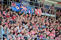 Lincoln City fans watch their team in action<br /> <br /> Photographer Chris Vaughan/CameraSport<br /> <br /> The EFL Sky Bet League Two - Lincoln City v Tranmere Rovers - Monday 22nd April 2019 - Sincil Bank - Lincoln<br /> <br /> World Copyright © 2019 CameraSport. All rights reserved. 43 Linden Ave. Countesthorpe. Leicester. England. LE8 5PG - Tel: +44 (0) 116 277 4147 - admin@camerasport.com - www.camerasport.com