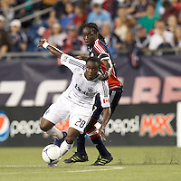 Vancouver Whitecaps FC midfielder Gershon Koffie (28) brings the ball forward as New England Revolution midfielder Shalrie Joseph (21) defends. In a Major League Soccer (MLS) match, the New England Revolution defeated Vancouver Whitecaps FC, 4-1, at Gillette Stadium on May 12, 2012.
